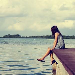 Girl On A Pier Photo